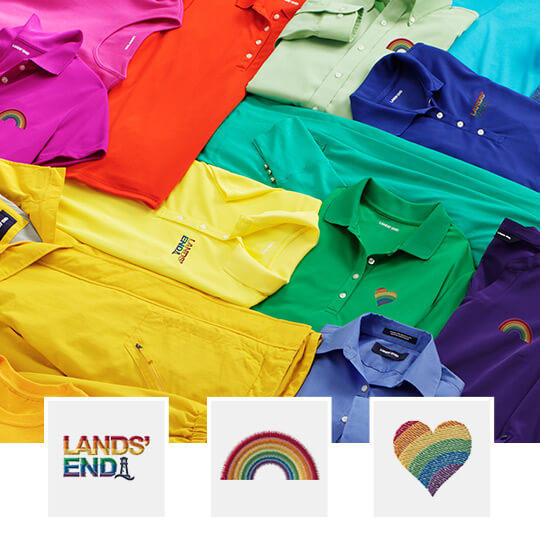 Several polos in the Pride Flag colors lay across one another. At the bottom, three embroidered logos overlap the picture: the Lands' End logo filled in rainbow colors, a rainbow, and a heart filled in rainbow colors.