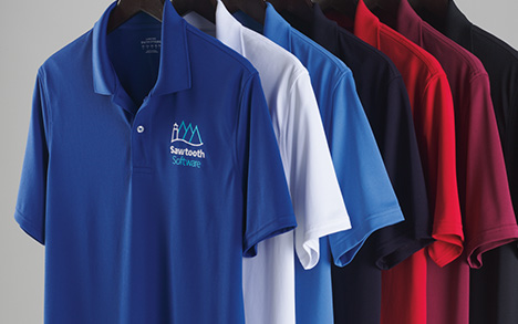 An assortment of different color active polos are arrange on hangers.