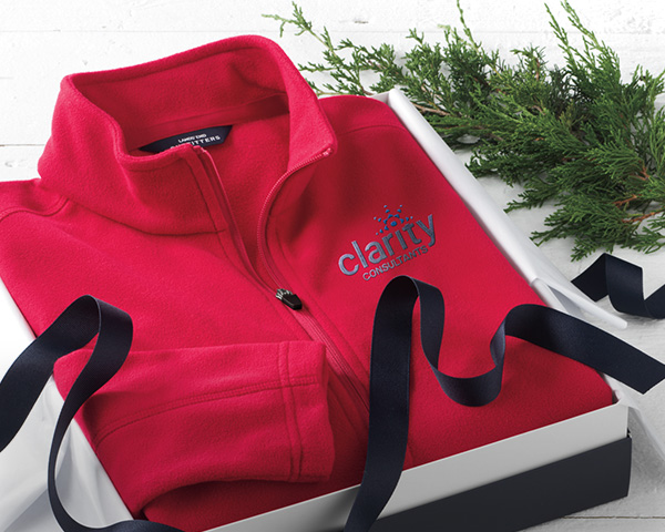 A red fleece in a gift box.