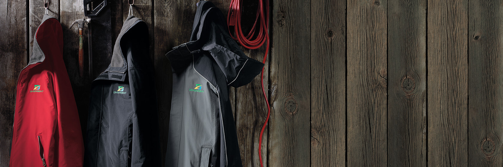 An assortment of durable jackets in a yard shed.