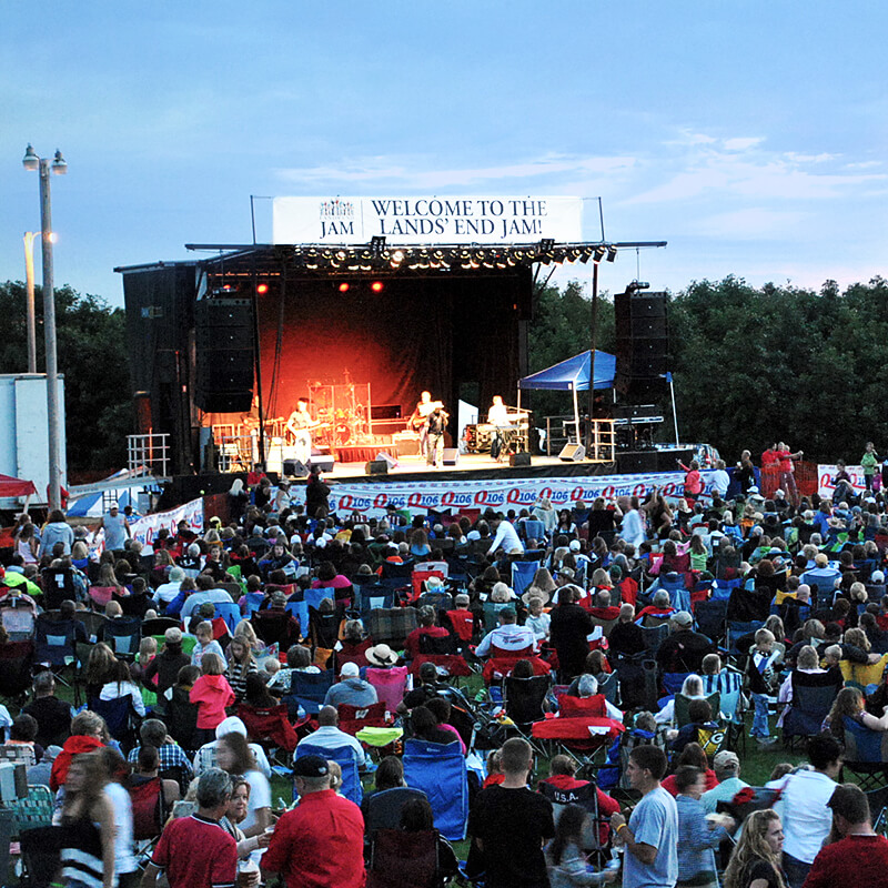 A picture of a stage for the Lands' End Jam, an annual summer concert held outdoors at our Dodgeville, WI campus.